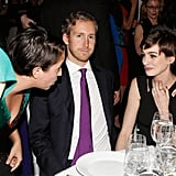 Anne Hathaway sat with her husband, Adam Shulman.
