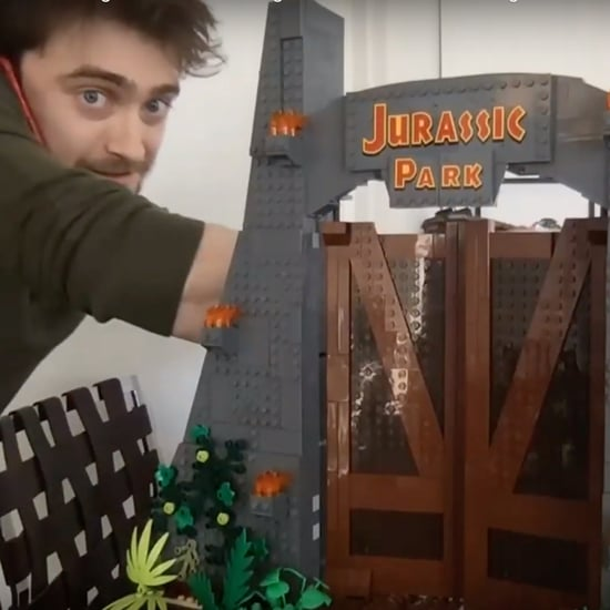 Daniel Radcliffe Doing Jurassic Park Lego Set in Isolation