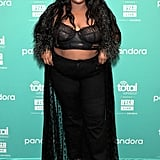 Yep, Lizzo can make even the simplest black outfit look incredible. Instead of a simple jeans and t-shirt combo, the singer went for a black bralette over a pair of high-rise black jeans and tied the look together with a sheer black cardigan that (of course) has fuzzy faux fur cuffs.