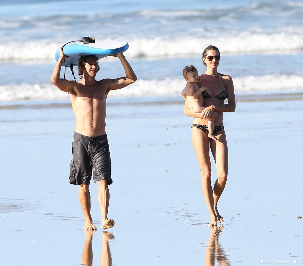 No, this is not a photo shoot. Gisele Bündchen dug her feet into the sand in Costa Rica on Wednesday, when she took her daughter, Vivian, to the beach for some fun in the sun. Gisele revealed her svelte figure in a teeny-tiny bikini, taking a moment to stretch as she took in the picturesque ocean view. Meanwhile, Vivian played with a doting dog and a surfer pal, who picked her up as the water swept beneath her. Gisele kicked off the Costa Rican fun over the weekend with a bikini photo shoot for H&M, which she followed up with a controversial helmet-free ATV ride with Vivian.  Tom Brady had a good reason for missing the family beach getaway. The pressure is mounting as Tom and his Patriots teammates prep for the AFC Championship game against the Denver Broncos on Sunday. He did get a break from the field to spend quality time with Ben at a Boston park last weekend.