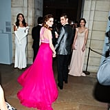 The cuteness continued as Emma and Andrew held hands while entering the event.