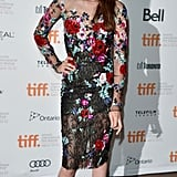 She took a girlie turn in a knee-length floral-print dress from Zuhair Murad's couture collection at the Toronto Film Festival in September 2012.