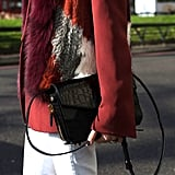 A sleek black croc bag was the perfect accompaniment to white jeans and a fur topper.