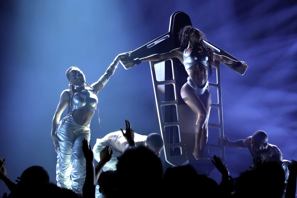 """Teyena Taylor had the best seat in the house at the 2021 MTV Video Music Awards. The singer and dancer made an unexpected appearance during Normani's elaborately choreographed performance of """"Wild Side,"""" which ended with Normani performing a gravity-defying lap dance to a strapped-down Taylor. The viral moment appeared to be an homage to Janet Jackson, who famously offered a similar routine to various lucky audience members at her 2001 All For You Tour, specifically as she performed the song """"Would You Mind."""" Following the performance, Teyana promptly tweeted, """"Surpriseeeeeee."""" Watch back the truly wild award show moment ahead.      Related:                                                                                                           The Skirt! The Cuffs! Please Direct Your Attention to Normani's Sexy White Set at the VMAs"""