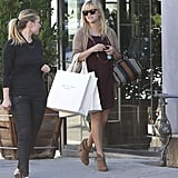 Reese Witherspoon wore a dress and sweater as she shopped.