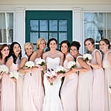 This bride squad wore dresses in pale pink and beige.