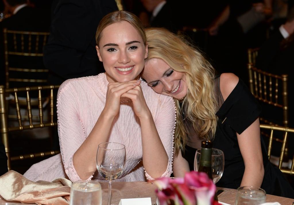 Suki Waterhouse and Poppy Delevingne looked adorable at their table during the gala.