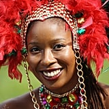 A woman in the Genesis Mas Band smiles ahead of the Notting Hill Carnival.