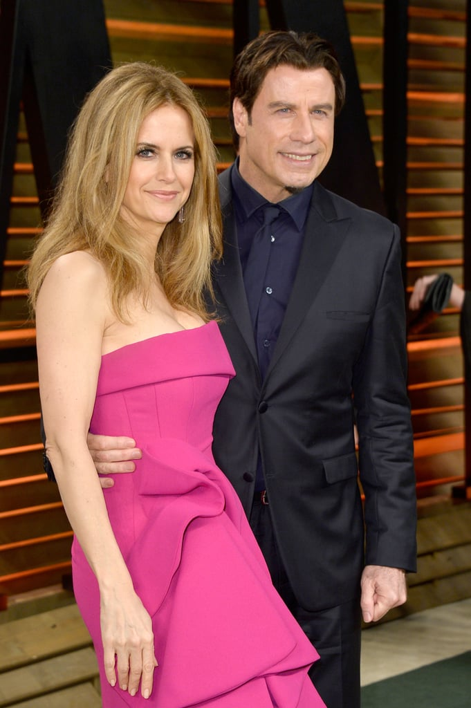 John Travolta and Kelly Preston posed for pictures at the Vanity Fair Oscars party.