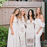 This bride had her bridesmaids match her in different styles of all-white dresses.