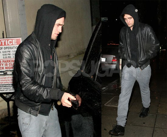 Robert Pattinson Gets Caught in the Rain