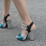 A flash of metallic on Caroline Issa's Prada heels.