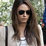 Mila Kunis wore a blazer and shades.