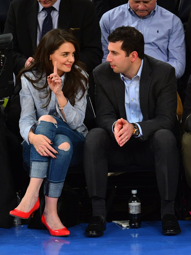 Katie Holmes wore ripped jeans and brightly colored pumps.