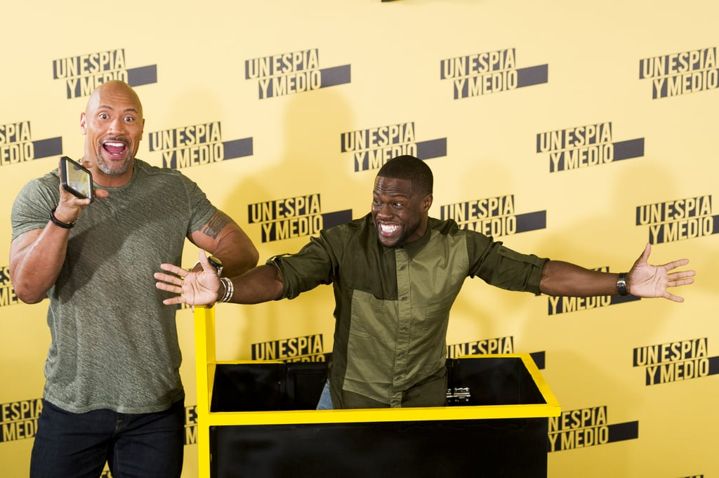 """On Tuesday, Dwayne Johnson attended a photocall for his latest film, Central Intelligence, with costar Kevin Hart in Madrid, Spain, and the two gave us yet another reason to love them. While there, the men put their playful personalities on display when Kevin surprised fans by arriving inside a box pushed by The Rock. And that was only the beginning! Once on stage, the stars snapped cute photos and shared a handful of laughs, once again proving that their friendship goes beyond the movie screen.  Later that day, Dwayne uploaded a video of himself thanking his fans for their support and also gave Kevin a sweet shout-out, saying, """"My partner Kevin Hart — I usually talk sh•t about him, but he's not here right now — I got to say, there's no one in Hollywood who works harder, no one who loves his fans more — well, accept myself — than Kevin Hart. I love you, brother."""" Keep reading for more fun pictures, then check out 17 times Dwayne made you laugh so hard, you almost cried."""