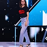 For a hosting gig at We Day California, Selena chose a red and black theme with her lip-print t-shirt and Mary Jane patent leather shoes. Her high-waisted distressed jeans had just the right amount of flare to be old-school and modern at once.