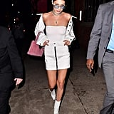 Bella Went For an All-White Ensemble Wearing a Strapless White Bodysuit, a Leather Skirt, and Matching Ankle Boots