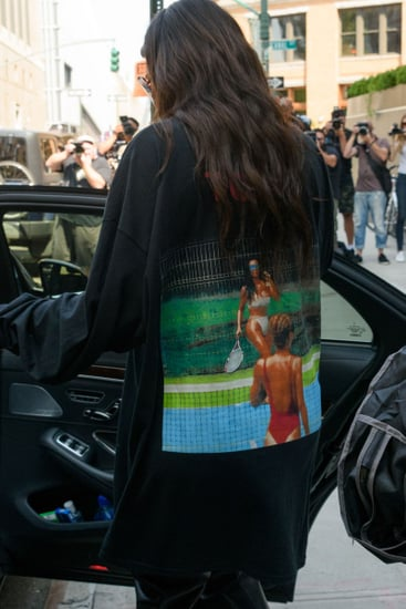 Kim Kardashian Wears Kanye West's Latest Saint Pablo Shirt Featuring a Photo of Herself Playing Tennis