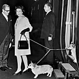 Queen Elizabeth II and a few of her prized pooches alighted on a London train platform in 1970.