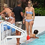 Doutzen Kroes and Sunnery James spent the afternoon at the pool with Phyllon.