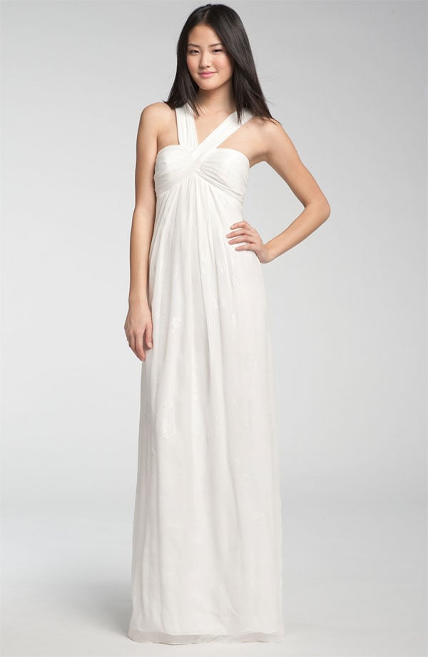 Draw attention to flatter a fit upper body with the halter neckline on this ultraversatile gown.  Nicole Miller V-Strap Gown ($575)