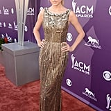 Swift sparkled in a gold formfitting Dolce & Gabbana number, which also featured a bejeweled art-deco-inspired neckline and a sexy low back, at 2013 Academy of Country Music Awards.