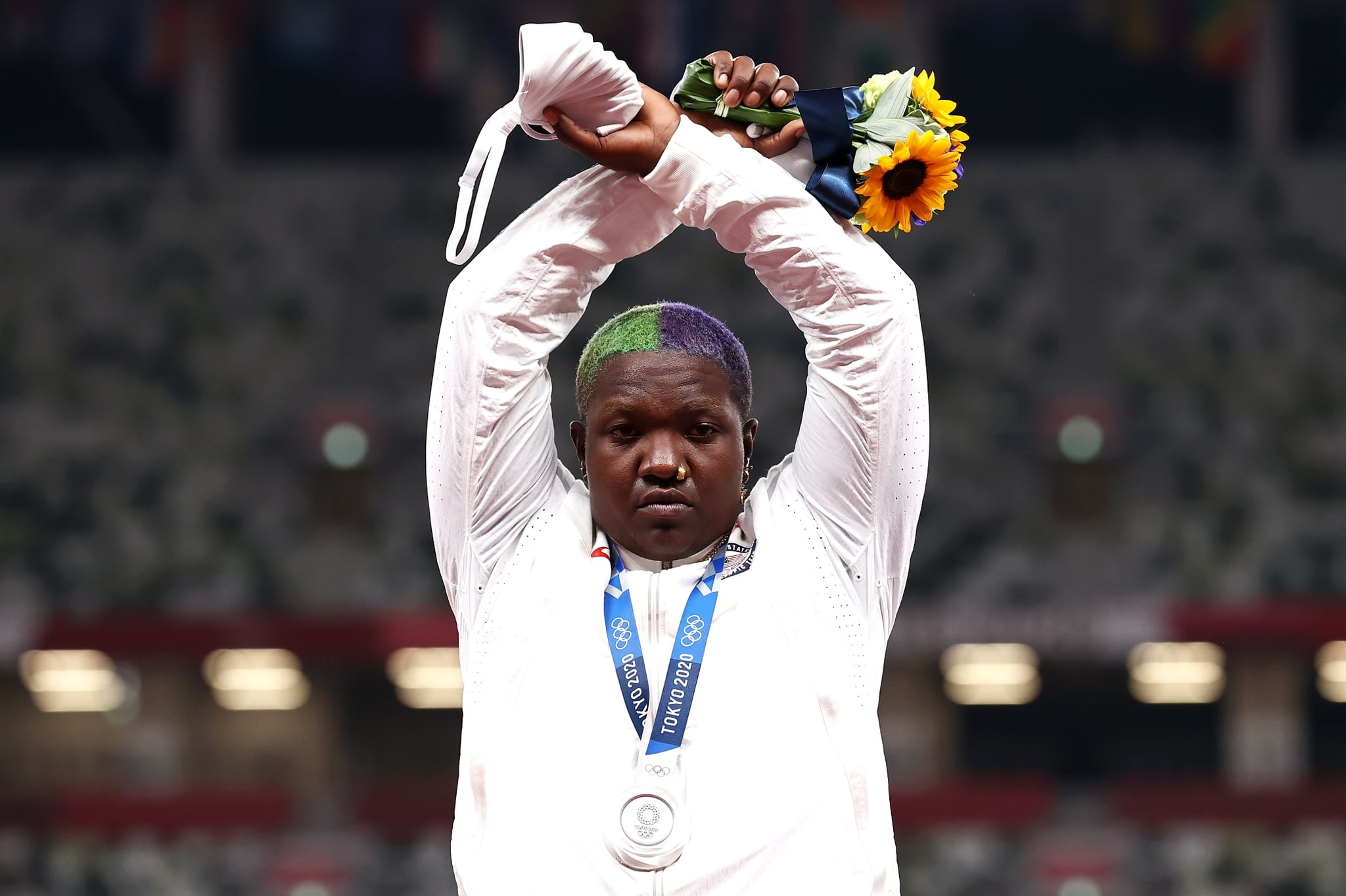 TOKYO, JAPAN - AUGUST 01: Raven Saunders of Team United States makes an 'X' gesture during the medal ceremony for the Women's Shot Put on day nine of the Tokyo 2020 Olympic Games at Olympic Stadium on August 01, 2021 in Tokyo, Japan. (Photo by Ryan Pierse/Getty Images)