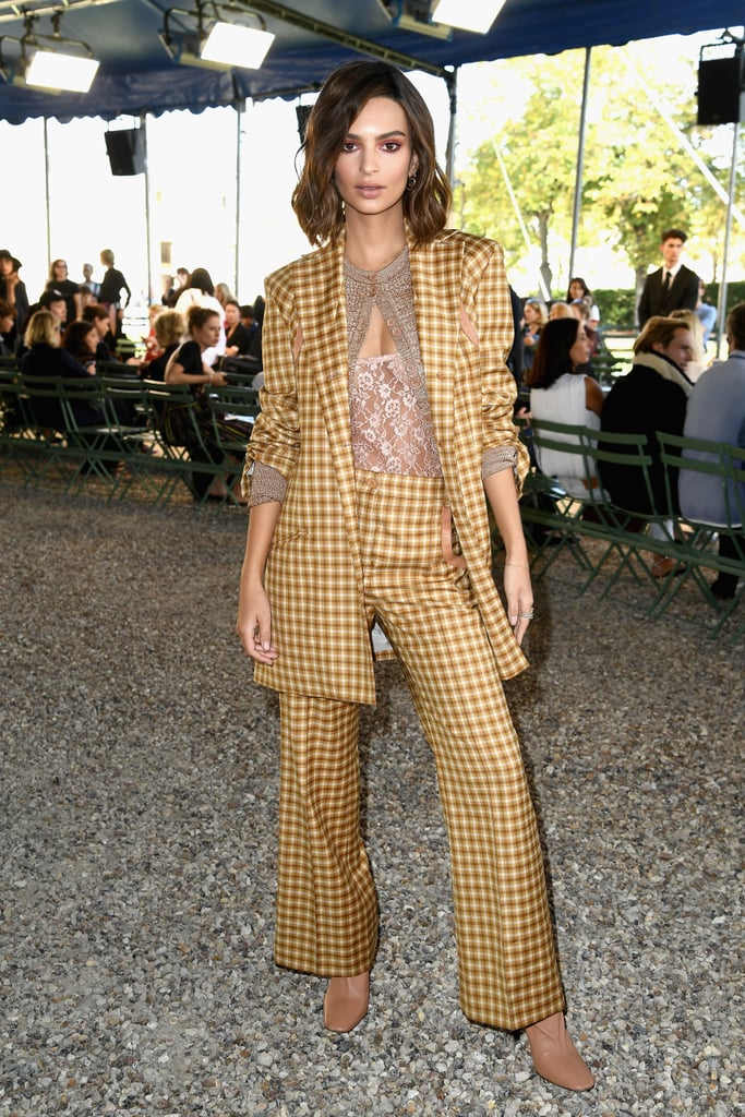 Emily Ratajkowski can take any look and give it that sexy spin — starting with menswear-inspired pieces. The star attended Nina Ricci's Spring '18 show in a two-piece plaid set from the designer's collection and looked right on trend for Fall.  To balance out the masculine feel of her oversize blazer, Emily wore a sheer pink lace top. The lingerie-like number was definitely sultry, but she continued to keep the look modest with a knitted sweater. The pieces all perfectly complemented one another, and her outfit even gave us an idea of how to style our own pantsuits. Read on for a look, then shop similar see-through tops.      Related:                                                                                                           When You See Emily Ratajkowski's Plaid Set, You'll Instantly Think of Cher Horowitz