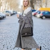 A Long Gingham Coat, Black Jeans, and Slides