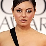 Mila Kunis Wears Black Dior For Her Golden Globes Presenting Duties