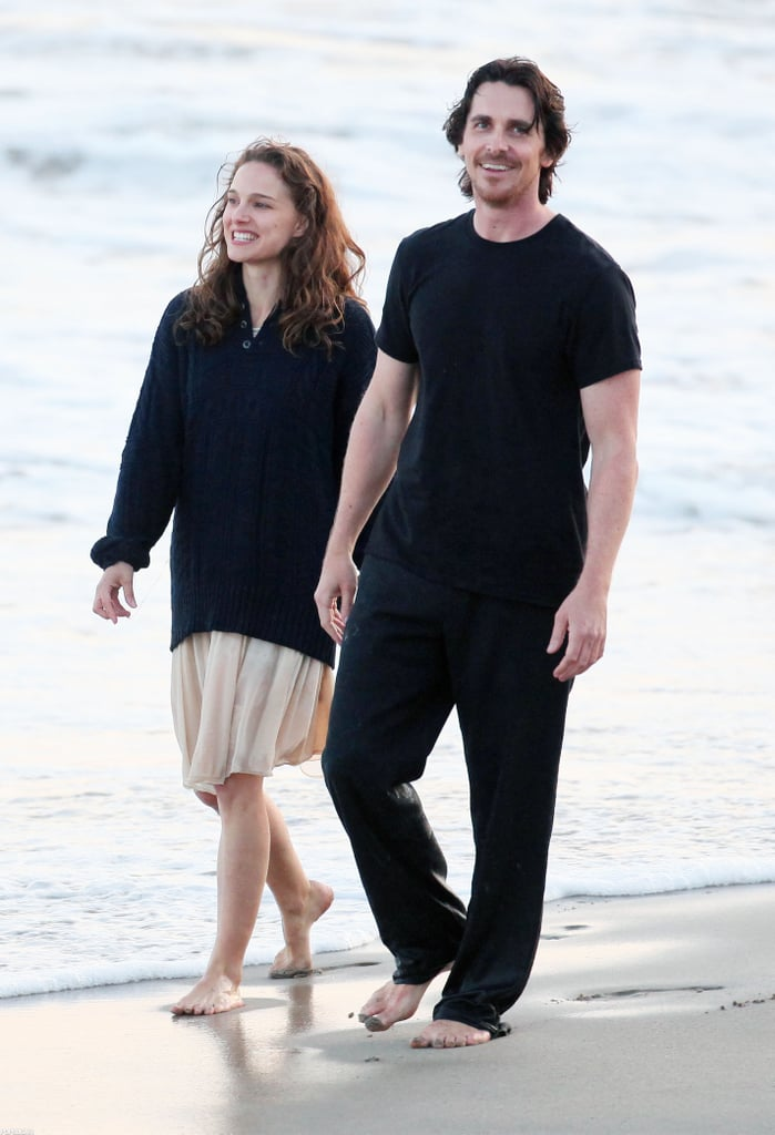 Natalie Portman and Christian Bale held hands on the beach in Malibu yesterday as they filmed Knights of Cups. The duo met up for the sunset shoot and got playful in the sand, including one scene where Christian put Natalie's hair in a ponytail. Christian is switching gears to his next project ahead of the Summer release of The Dark Knight Rises. While doing press for the action film, Christian opened up about dating Drew Barrymore, though their relationship apparently only lasted one night.  Natalie, meanwhile, has been busy focusing on family. Natalie and her son, Aleph, hung out at an LA park last week. Last month, though, she was in NYC to join husband, Benjamin Millepied, for a night at the NYC ballet.