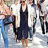"""Selena soaked up the last few weeks of Summer in her dot-print midi dress from Rouje. The easy """"toss on and go"""" piece was worn with a cardigan, Roberi & Fraud frames, and Louis Vuitton sneakers."""