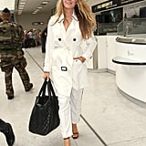 When she arrived into nearby Nice airport, Blake Lively wore a white Burberry trenchcoat.