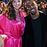 Miranda Kerr posed backstage with Kanye West in 2011.