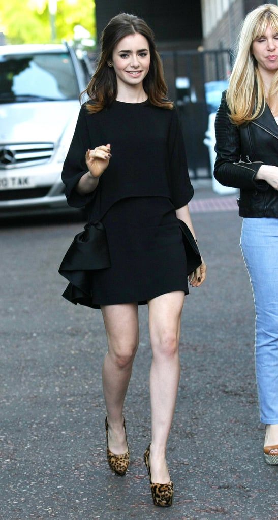 While out and about in London, we were surprised to see Lily's now-famous abs covered up — but she compensated with a leg-flaunting mini hemline.