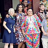 While posing with members of the Peace Corps, Michelle was a standout in the design.
