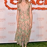 Maggie Grace opted for easy, breezy elegance via a loose-fitting floral maxi dress and beachy hair.