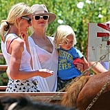 Gwen Stefani at a petting zoo with Zuma.
