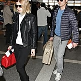 Kate Mara kept things edgy in a black motorcycle jacket and loafers — accented with a red bag.