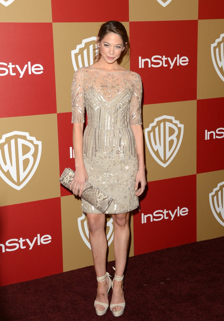 Analeigh Tipton showed off her stems in a sheer-infused, shimmery minidress with chunkier ankle-strap heels.