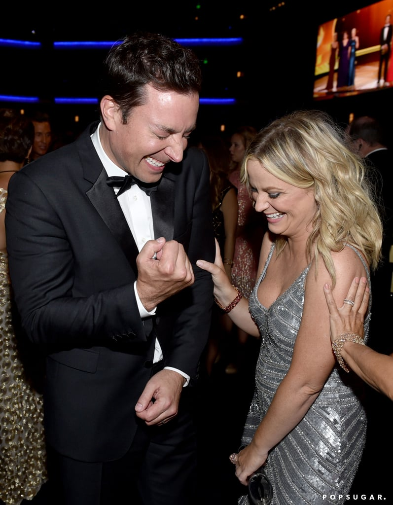 Jimmy Fallon and Amy Poehler kept their antics going backstage.