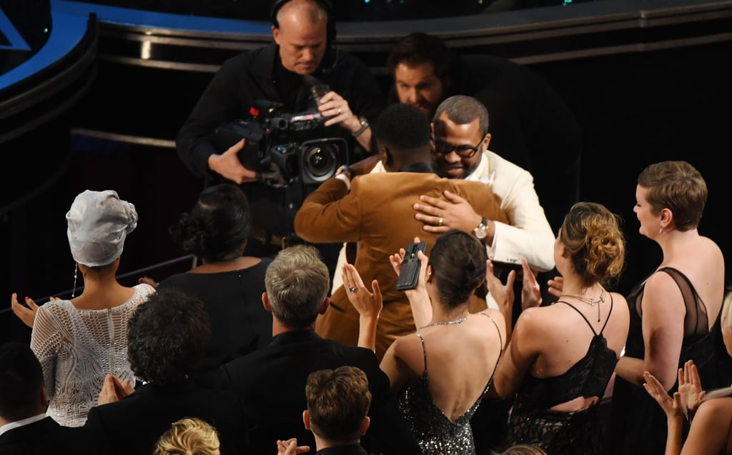 Jordan Peele got a hug from Daniel Kaluuya when he was announced the best original screenplay winner for Get Out.