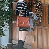 Taylor Swift wore a brown bag.