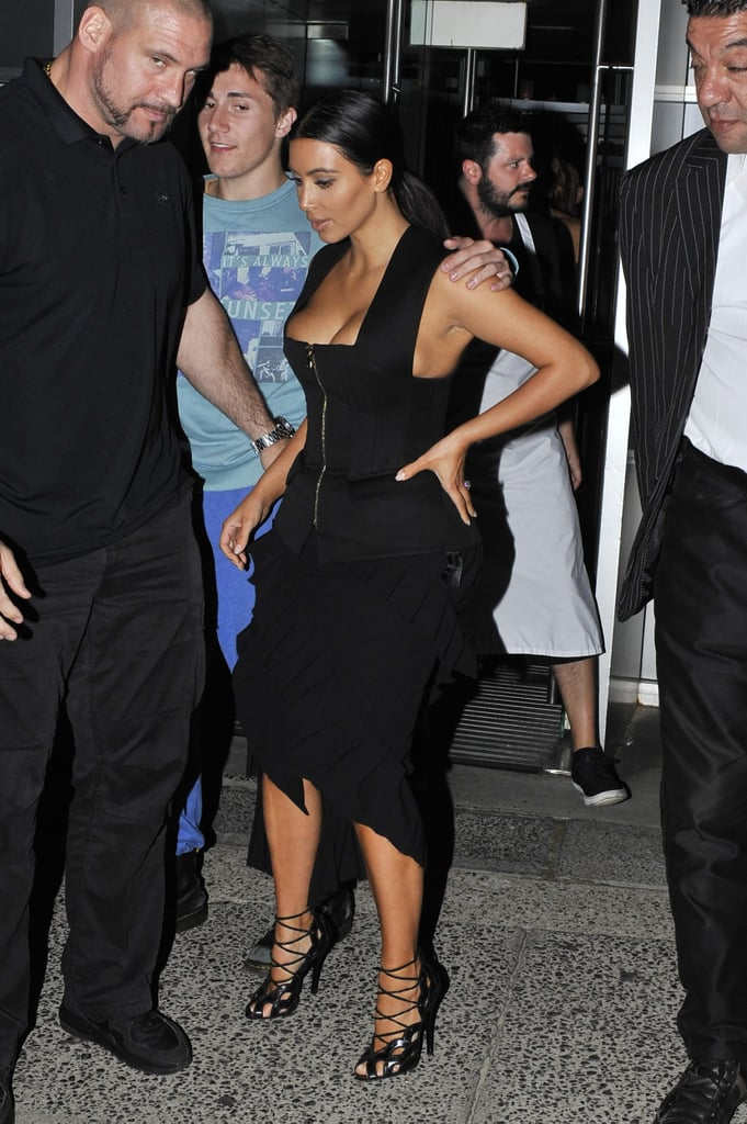 It's been only two months since her last visit, but Kim Kardashian is already back in the country. Kim was spotted leaving LA on Saturday and arrived in Sydney on Sunday morning wearing a low-cut black jumpsuit, giving everyone a glimpse of her famous cleavage. As always, she looked perfectly polished, and then a few hours later she emerged as her glamorous self for dinner at Bondi's Icebergs, where she almost had a wardrobe malfunction when her Balmain ensemble shifted down around her bust area. Fans gathered around her for photo opportunities, but she was quickly ushered inside the restaurant and taken to a private dining area. Kim, who travelled without Kanye West and their daughter North, is in Australia for the launch of her latest fragrance, Fleur Fatale, and will attend a VIP event in Melbourne on Tuesday night as part of her duties. She has also been the subject of plenty more headlines than usual in the past week thanks to her nude photo shoot with Paper magazine, which garnered heaps of celebrity reactions and funny memes.