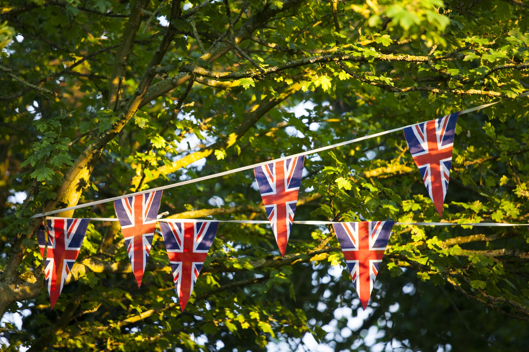 UNITED KINGDOM - JUNE 04:  Union Jack flag bunting at street party to celebrate the Queen's Diamond Jubilee in Swinbrook in the Cotswolds, UK  (Photo by Tim Graham/Getty Images)