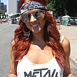 Red hair was a popular trend among the celebrities this Summer, and this redhead caught our eye with her fiery waves and heavy-metal accents.