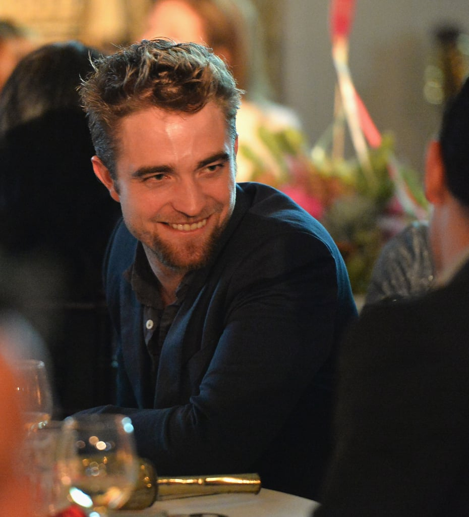 Robert Pattinson has finally shaved that beard and is now sporting a goatee. The actor debuted his new facial hair when he attended the 6th annual Go Go Gala at the Bel Air Bay Club in LA yesterday. The actor looked like he was in a great mood, chatting with fellow guests and posing for photos with host Adam Shankman. The dinner featured also featured an auction, and Rob won a cello made out of recycled material after putting up $5,600.  Rob's rumored new love interest, Dylan Penn, was not at the event, but that doesn't mean she has been laying low. Dylan recently had dinner with her father, Sean Penn, and another handsome man, Jon Hamm, after the premiere of Sean's new film, The Secret Life of Walter Mitty in LA on Wednesday.  If you can't get that new facial hair out of your head, be sure to vote in our poll on Robert Pattinson's goatee!