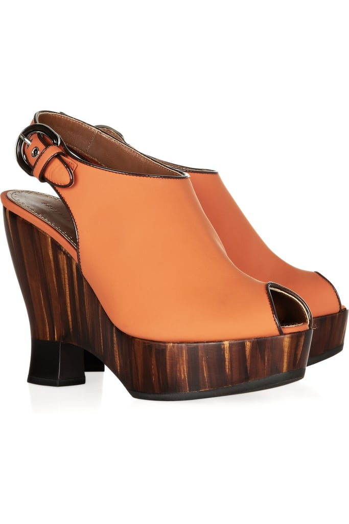 Proenza Schouler's neoprene and wooden sandals have the ultimate jungle-cool appeal.  Proenza Schouler Wooden Wedge Sandals ($1,385)