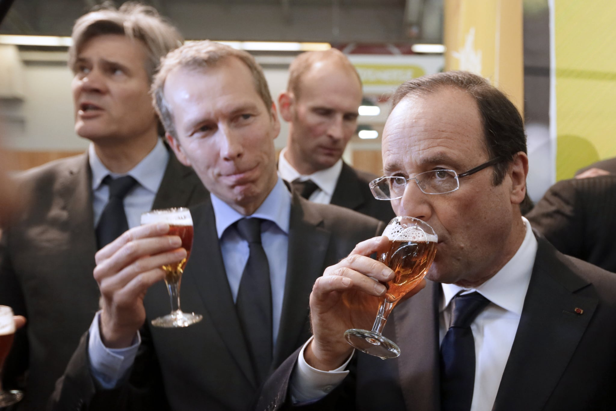 French President Francois Hollande drank a beer during an agriculture fair in Paris in 2013.