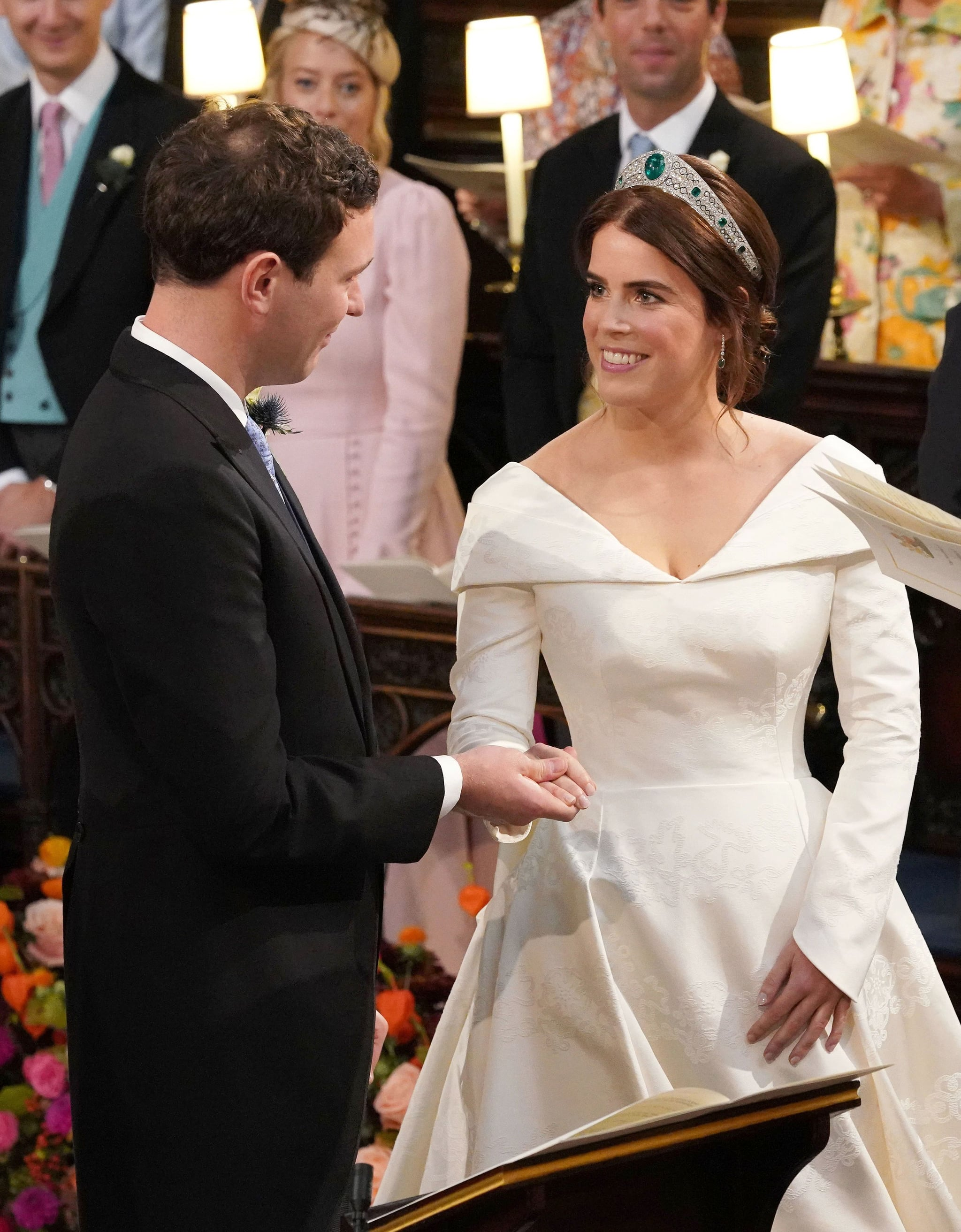Britain's Princess Eugenie of York (R) is married to Jack Brooksbank during their wedding ceremony at St George's Chapel, Windsor Castle, in Windsor, on October 12, 2018. (Photo by Jonathan Brady / POOL / AFP)        (Photo credit should read JONATHAN BRADY/AFP/Getty Images)